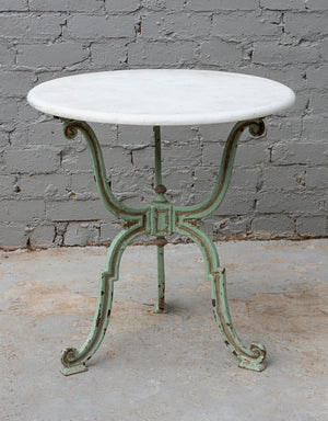 A pale green painted cast iron tri-form garden table, French 19th Century