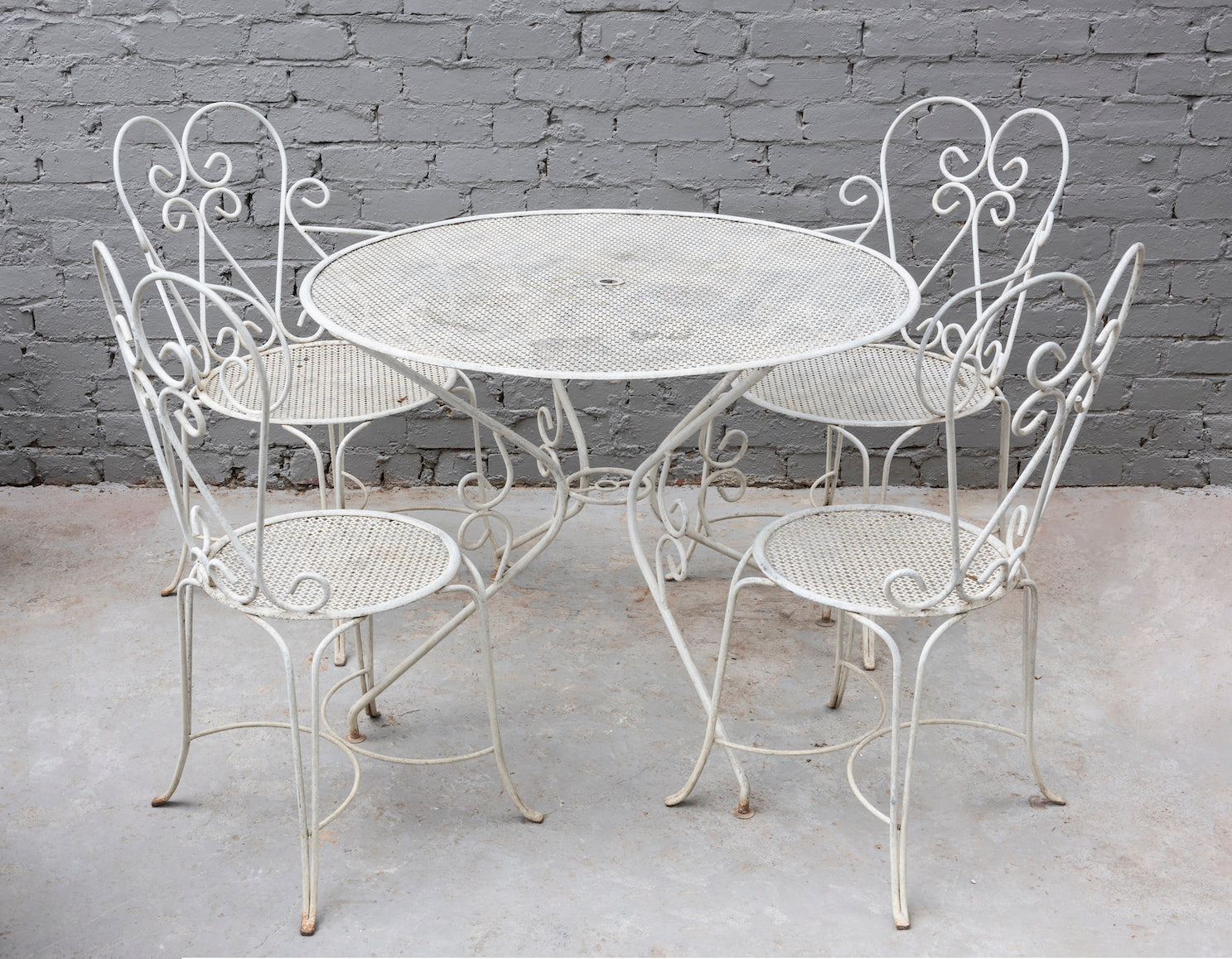 SOLD A white painted metal five piece garden setting, French Circa 1950