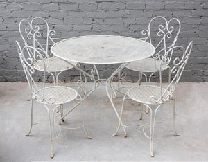 A white painted metal five piece garden setting, French Circa 1950
