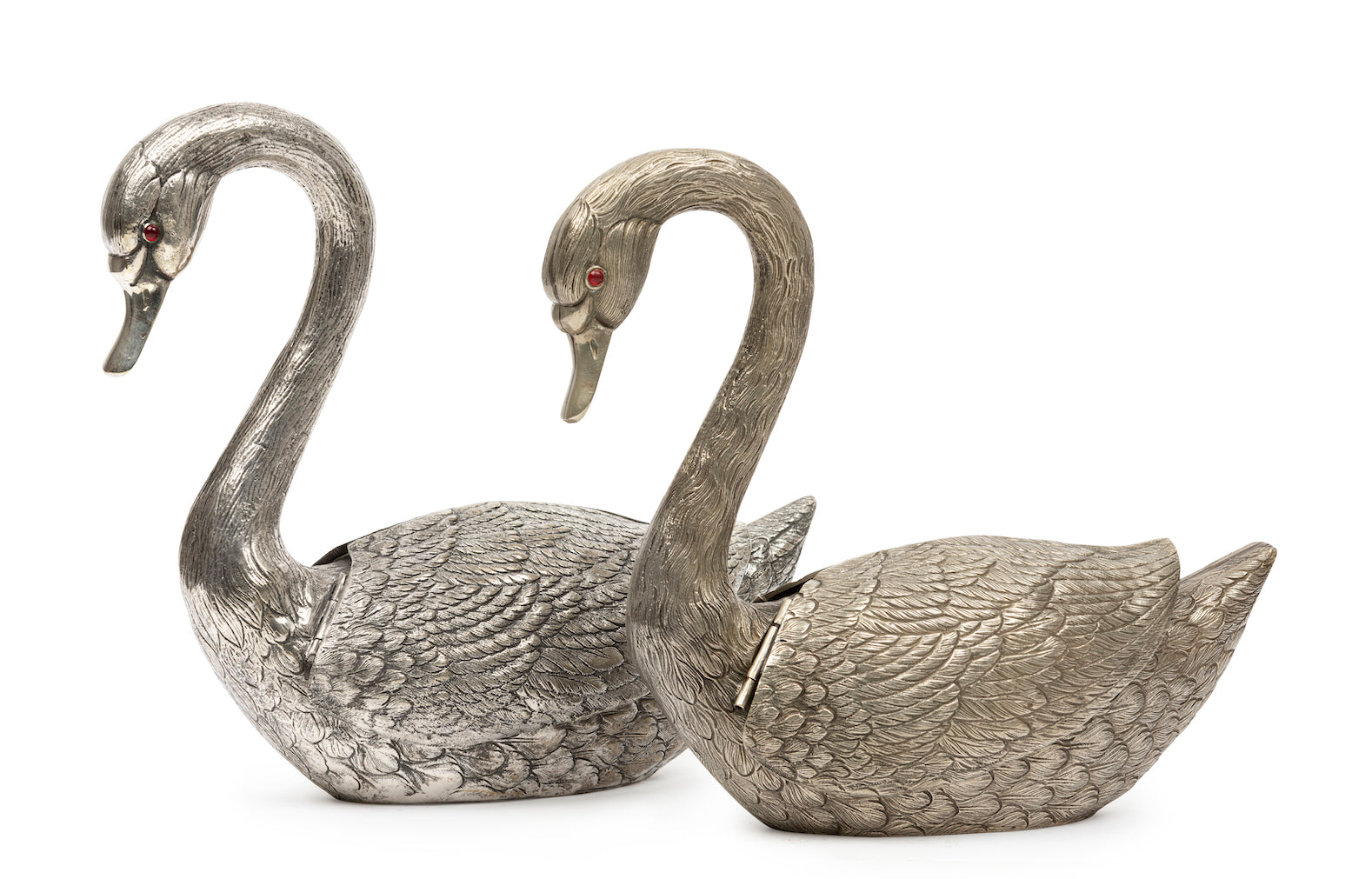Two silver metal swan form vases with reticulated wings and glass eyes, Continental Circa 1900