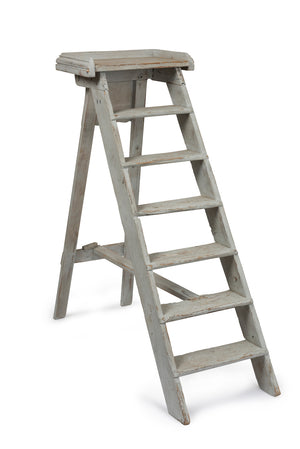 A white painted seven tread library ladder labelled B.N Paris