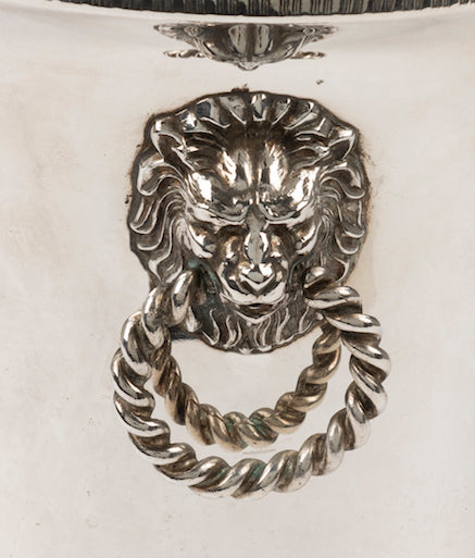 A silver plated circular wine cooler with lion mask ring handles, French Circa 1950