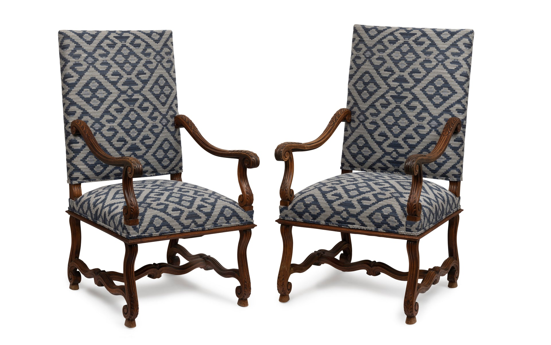 A pair of acanthus design carved walnut armchairs, French 19th Century