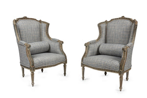 A stylish pair of Louis XVI style grey-painted French wingback chairs