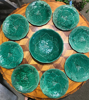 A beautiful vine-pattern dark green faience salad setting, French Circa 1900