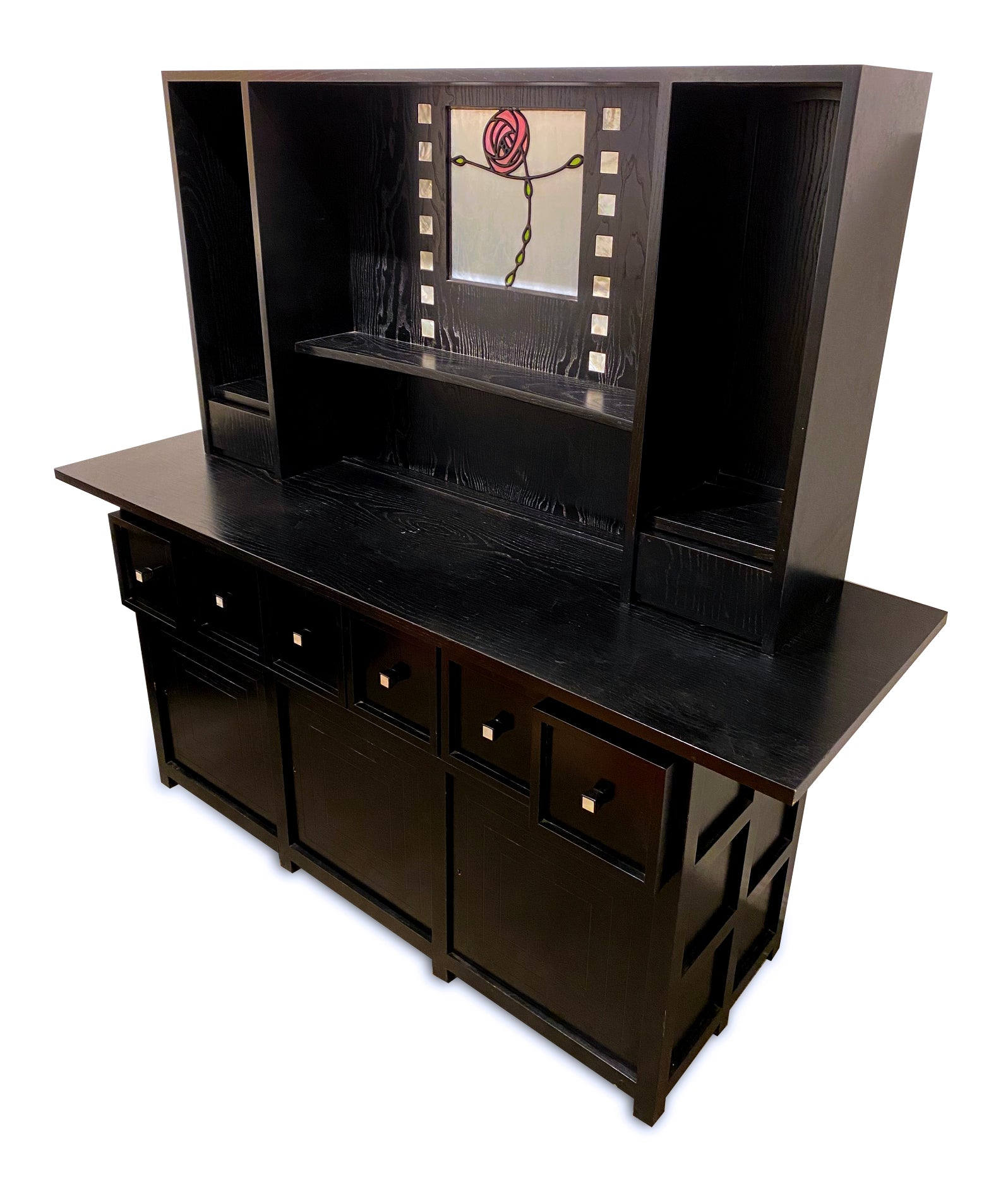 An ebonised and leaded glass cabinet after Charles Rennie McIntosh made by Cassina