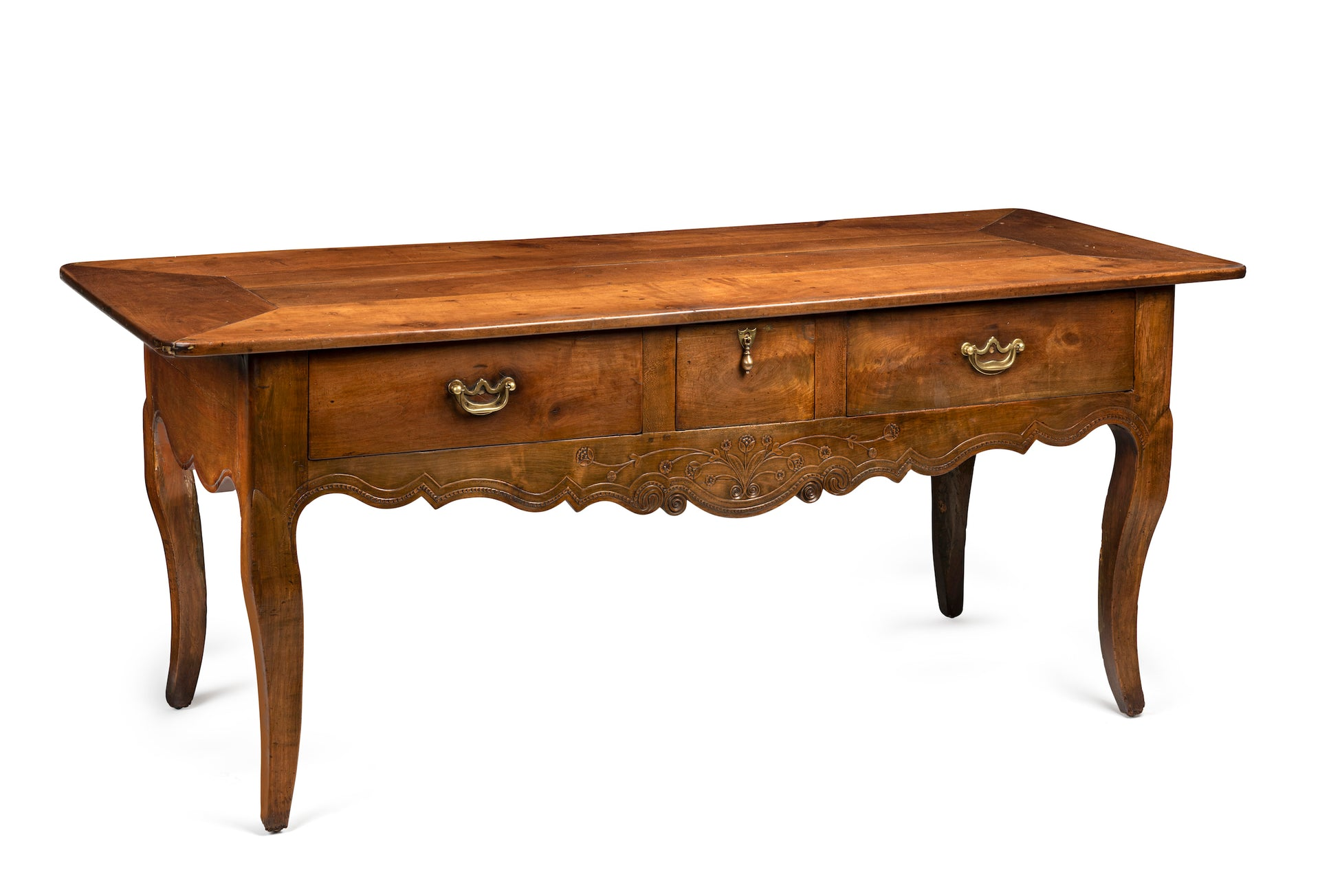 A beautifully carved Provincial cherrywood serving table, French 18th Century