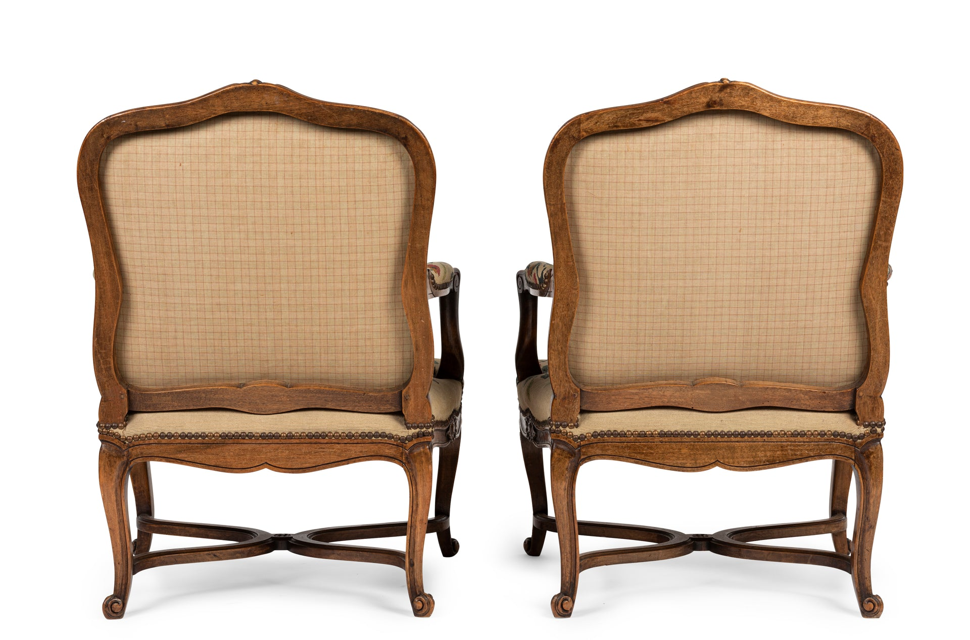 A beautiful pair of Louis XVI style fauteuils with original needlework upholstery, French 19th Century