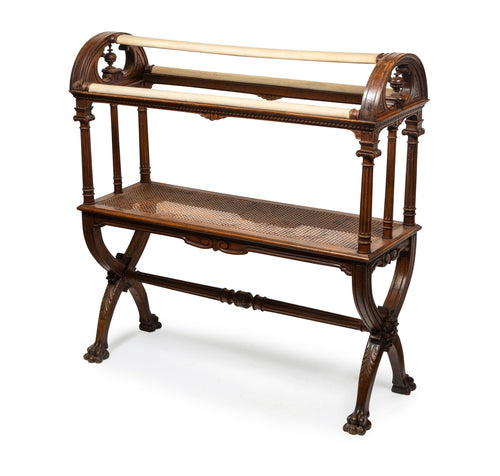 A rare carved walnut and caned saddle stand, English Circa 1880