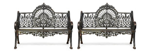 A beautiful pair of black painted cast iron garden seats in the Colebrookedale Peacock pattern, English 19th Century