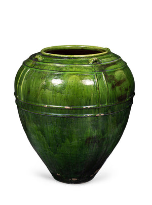 An exceptional vintage terracotta and bottle green glazed giant ovoid jar form urn, Italian