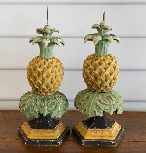 A pair of Italian decorative polychrome painted carved pineapple form candlesticks