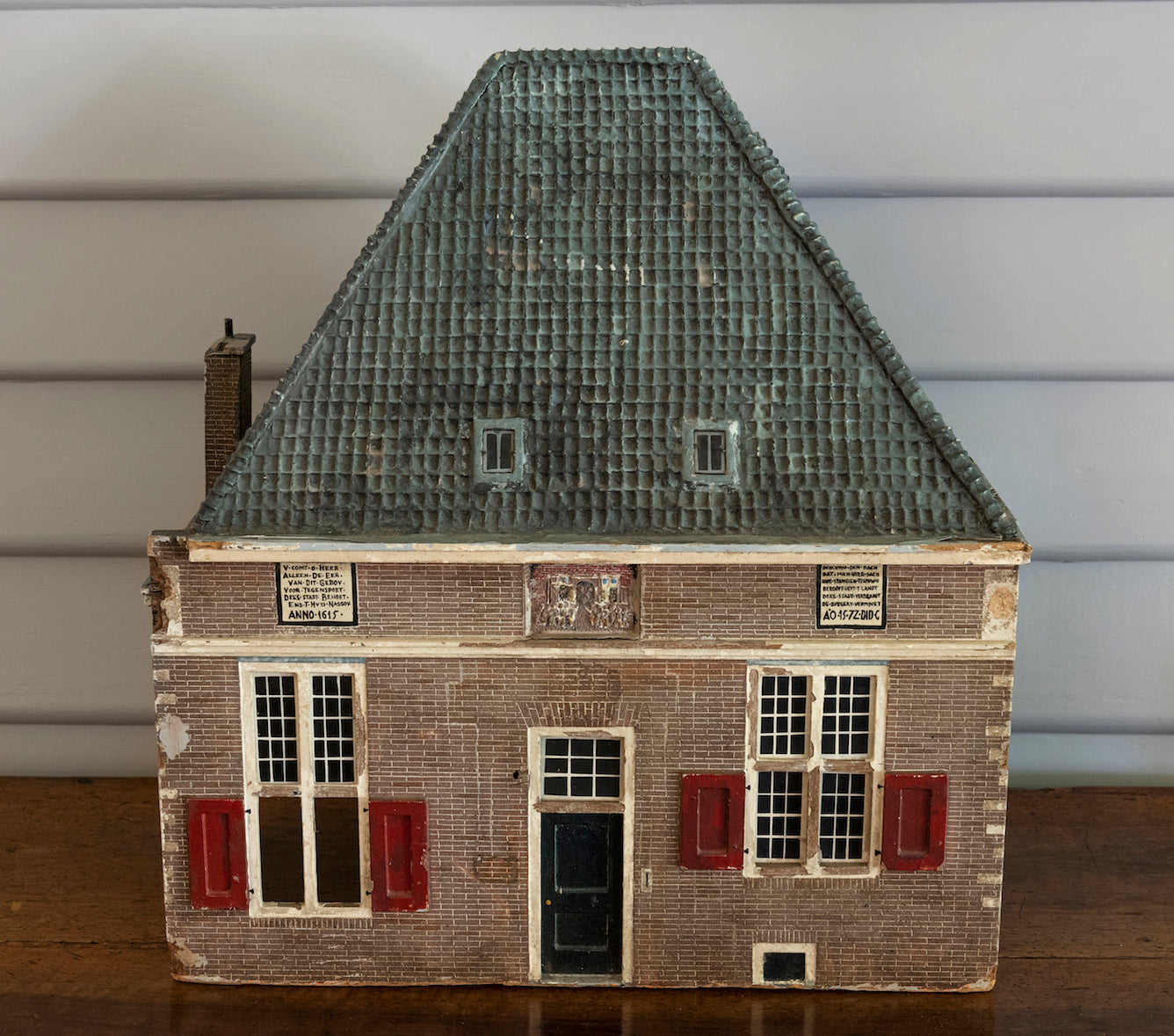 A charming polychrome painted wooden model of a house, Swedish 19th Century