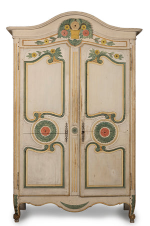 A very pretty carved and polychrome painted two door Armoire, French 19th Century
