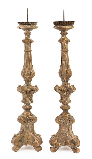A pair of giltwood torchere candlesticks, Italian 18/19th Century