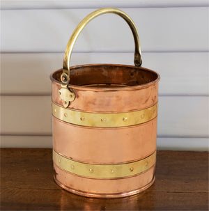 A copper and brass banded bucket with brass handle, French 19th Century