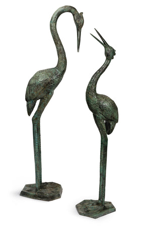 A beautiful pair of large bronze water birds with verdigris finish, in the Japanese style