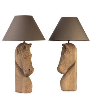 A pair of unusual carved French natural oak stylized horse-head form table lamps