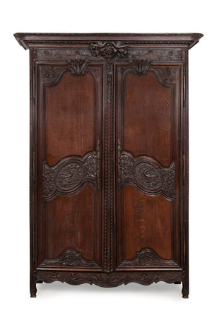 A beautifully carved dark oak Armoire Marriage, French early 19th Century