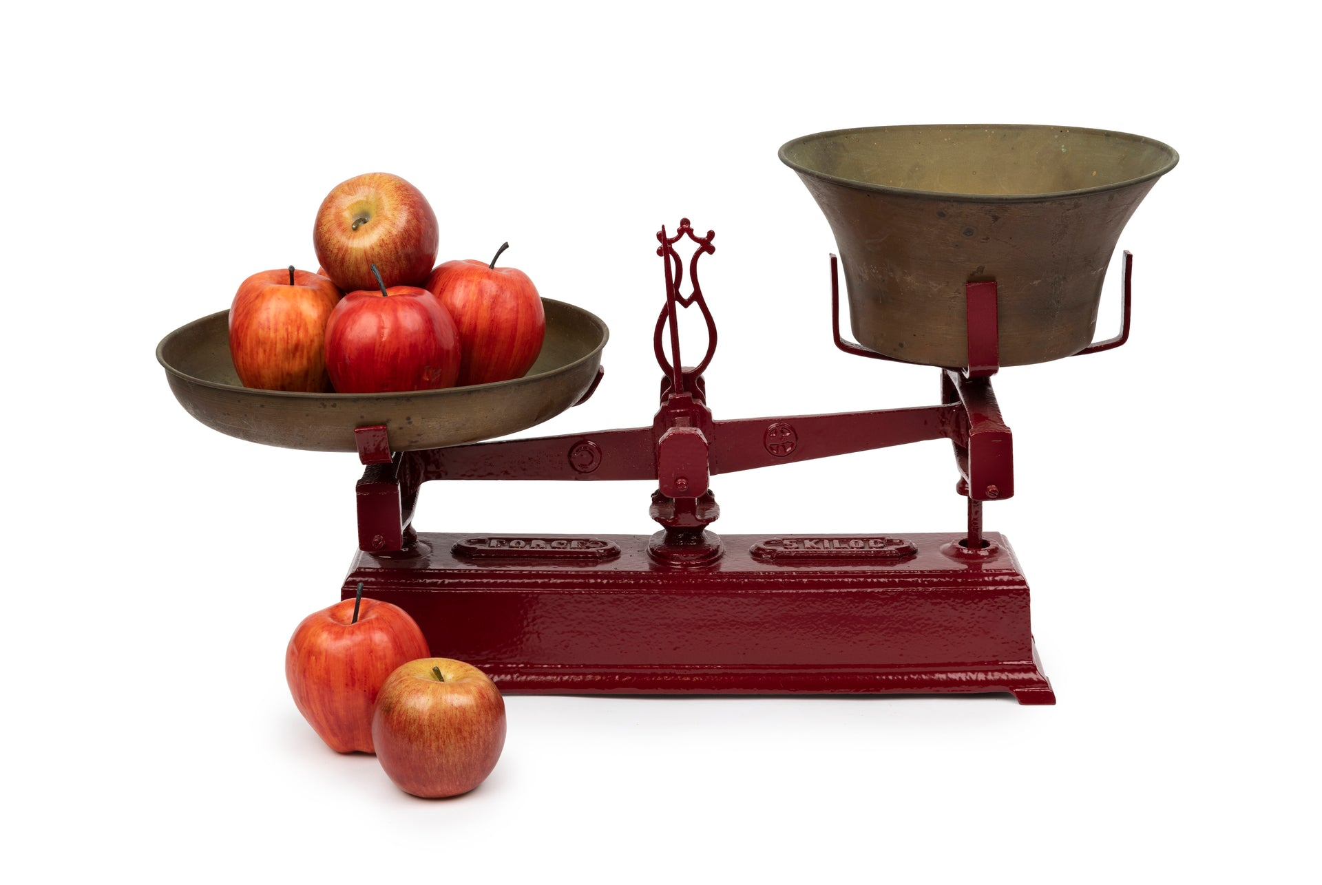 A set of cherry red painted cast iron and brass scales, French 19th Century