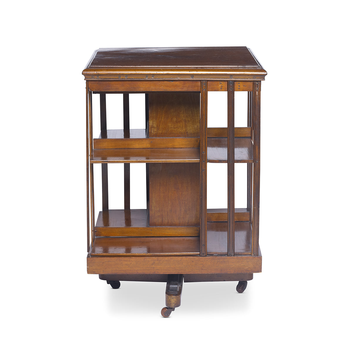 A very good quality Virginian-walnut two tier revolving bookcase, English Circa 1900
