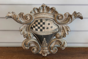 A very decorative Italian grey painted carved wooden coat of arms