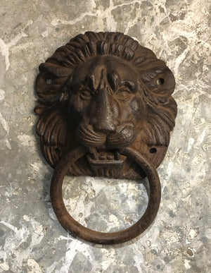 A cast iron lion mask and ring design door-knocker, French 19th Century