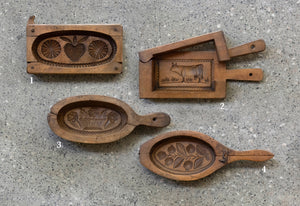 A collection of hand carved wooden butter and shortbread moulds, French 19th Century