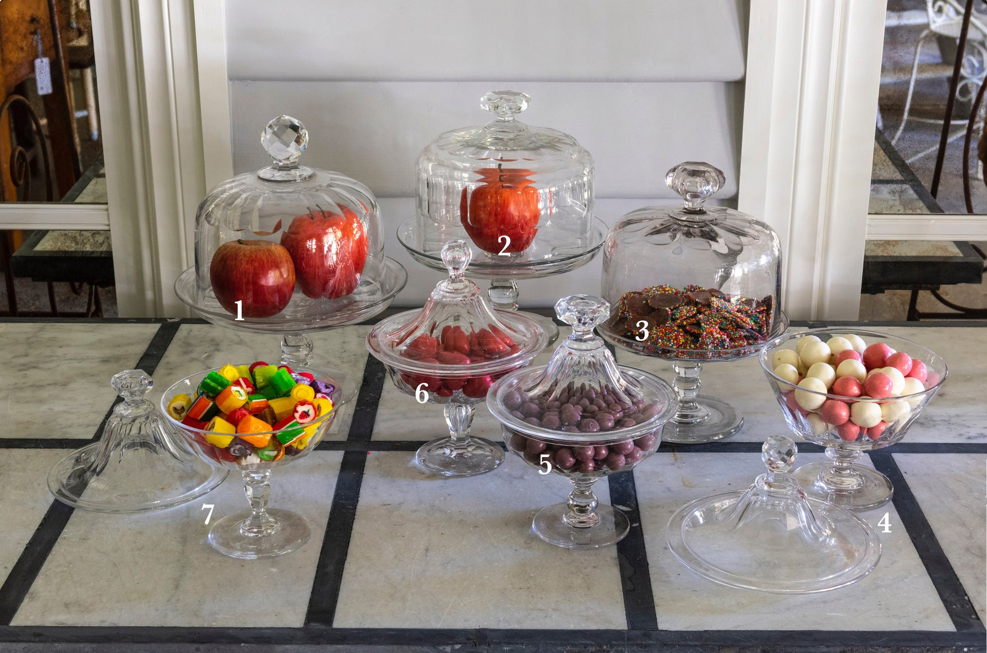 A collection of French vintage cut glass compotes and cloches