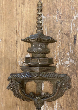 An unusual vintage Chinoiserie pagoda form and swinging monkey bronze door knocker 40cm high, 225cm wide, 4cm deep