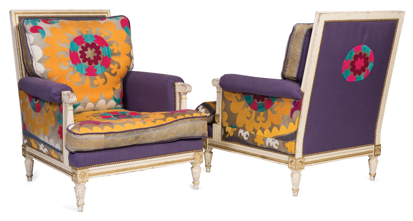 An exceptional pair of white and gilt decorated Louis XVI style armchairs,  French 19th Century