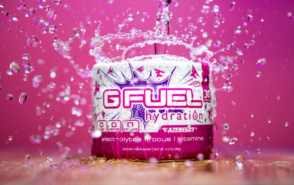 A FaZeberry G FUEL Hydration tub is being splashed by water.