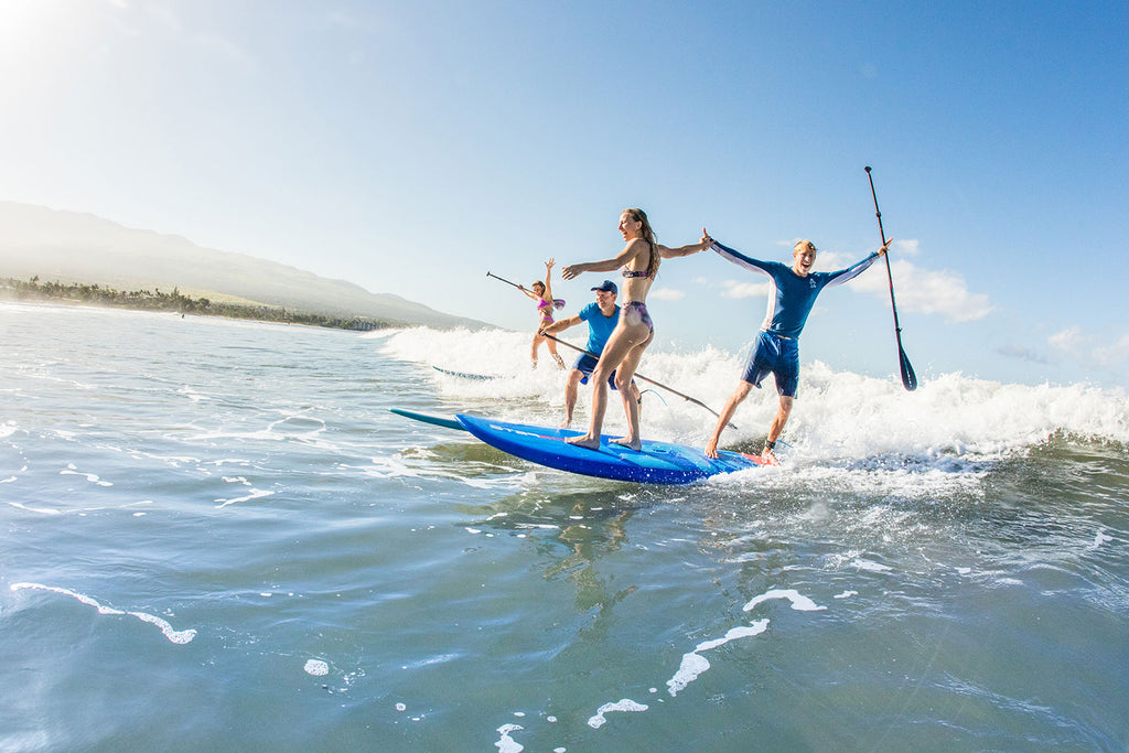 the starboard sup team paddleboarding together
