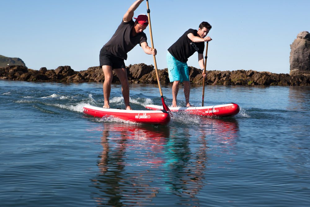stand up paddleboard racing on inflatables