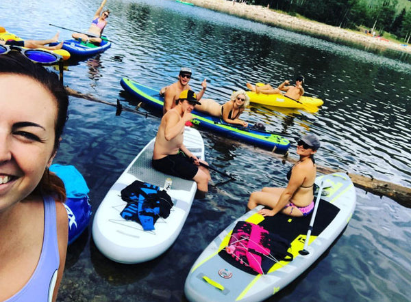 crew hanging on a paddle board