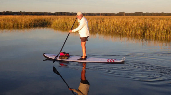 having fun stand up paddle boarding