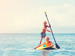 kids stand up paddleboarding