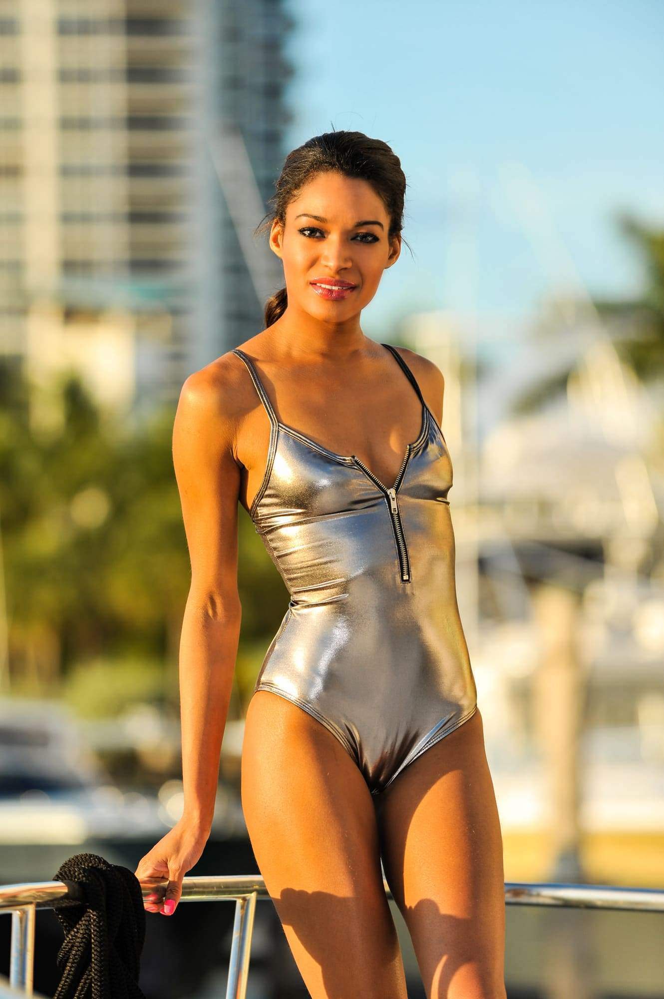 7 Sexy Ways to Wear a Shiny Swimsuit and Up Your Festival Fashion Game