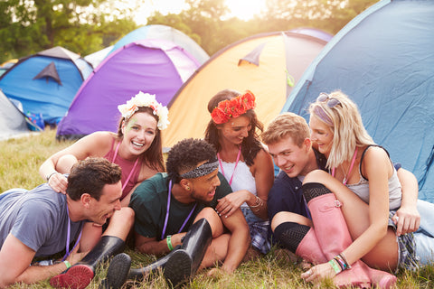 Friends hang out at EDM festival campsite