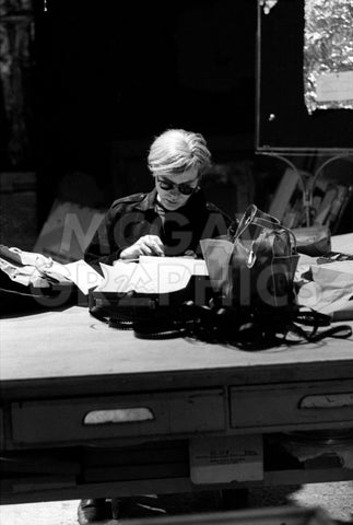 Andy at Typewriter, The Factory, NYC, circa 1965 -  Andy Warhol/ Nat Finkelstein - McGaw Graphics
