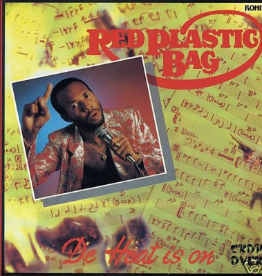 RED PLASTIC BAG - De Heat Is On