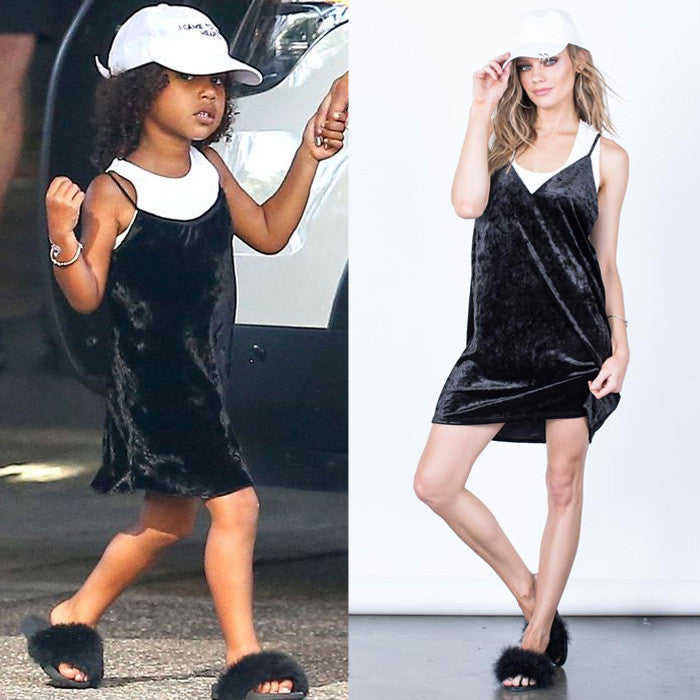 north west in a velvet slip dress