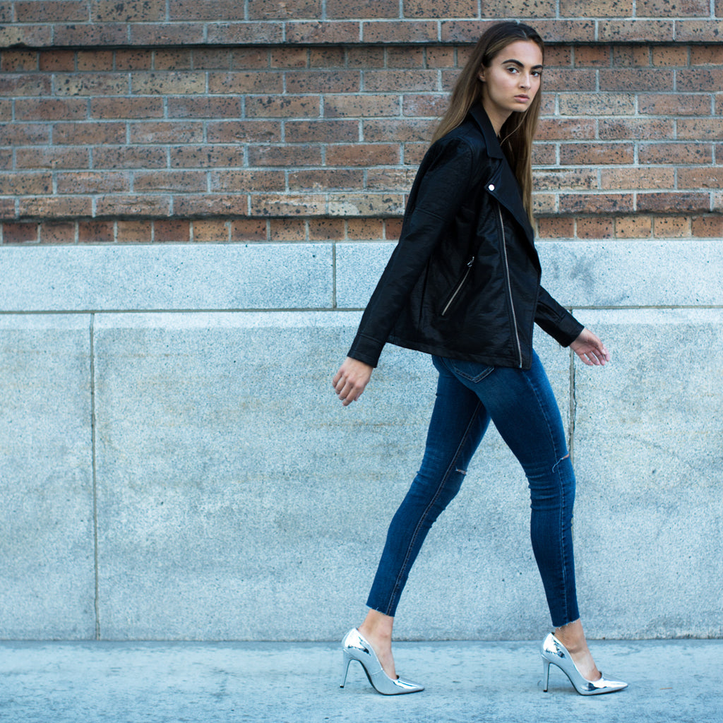 leather jacket blue jeans metallic pumps