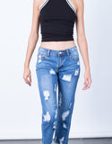 Detail of All Around Distressed Denim Jeans