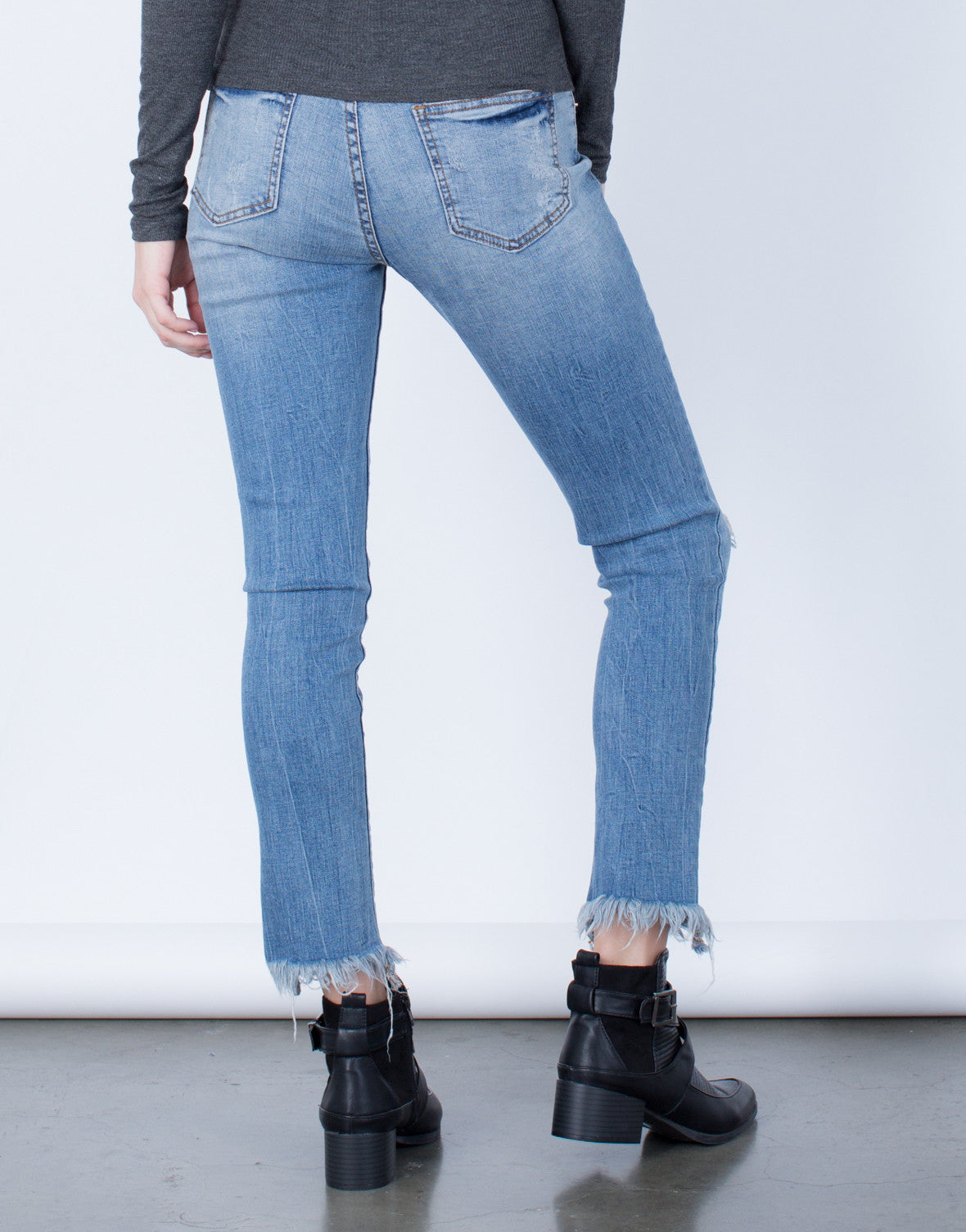 Back View of Blurred Frayed Hemline Jeans