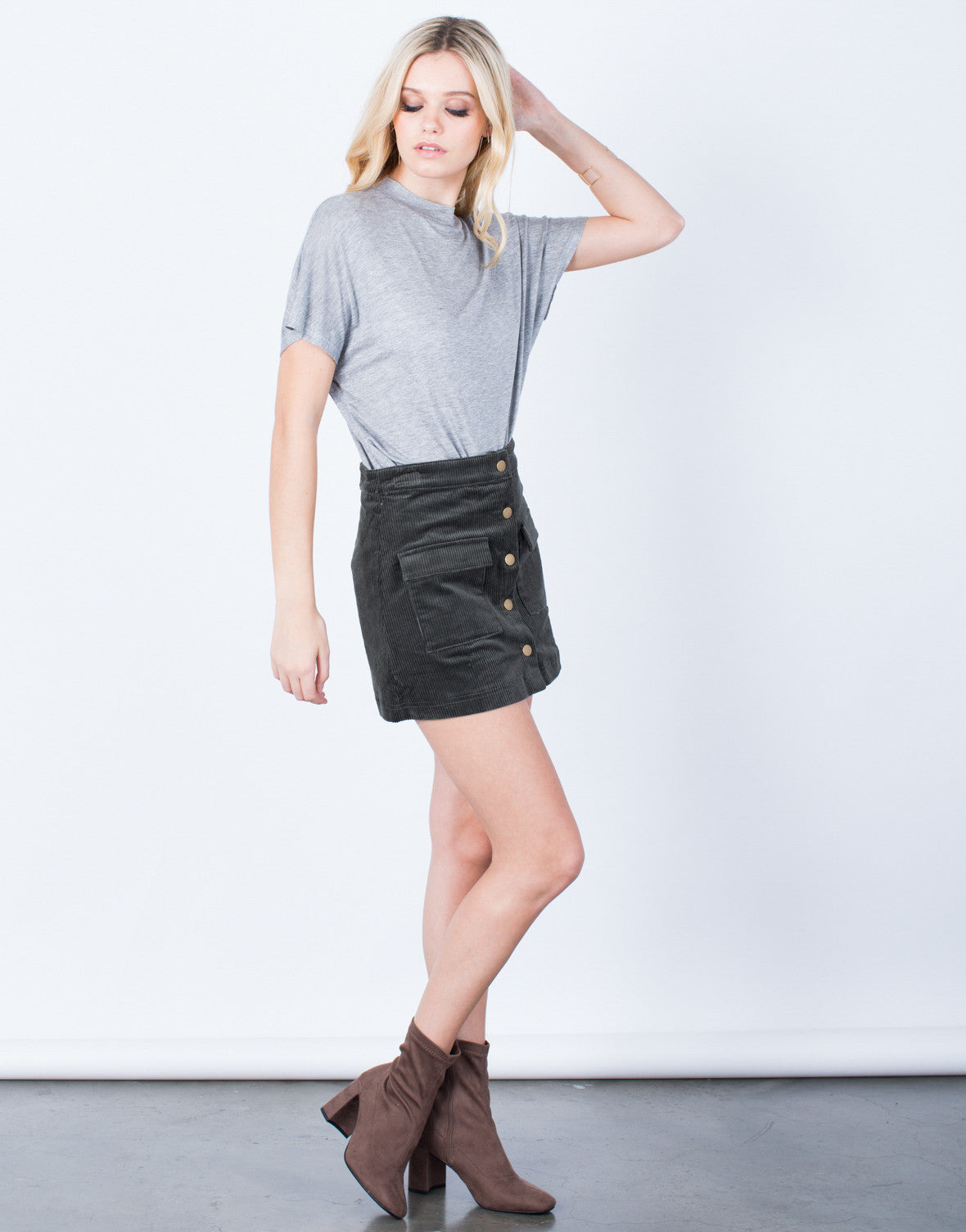 Side View of Buttoned Corduroy Mini Skirt