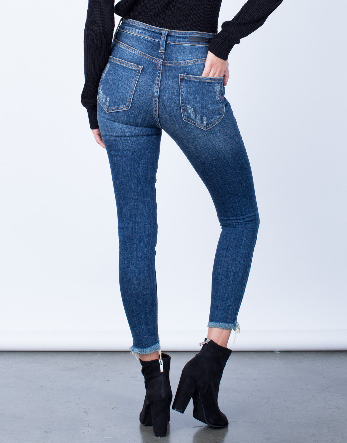 Back View of Cropped Hem Mid Rise Jeans
