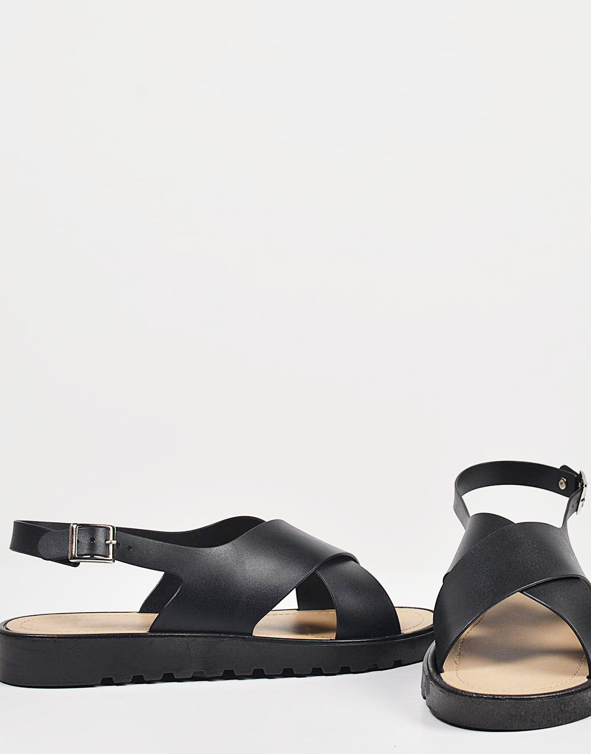 Detail of Crossed Jelly Slingback Sandals
