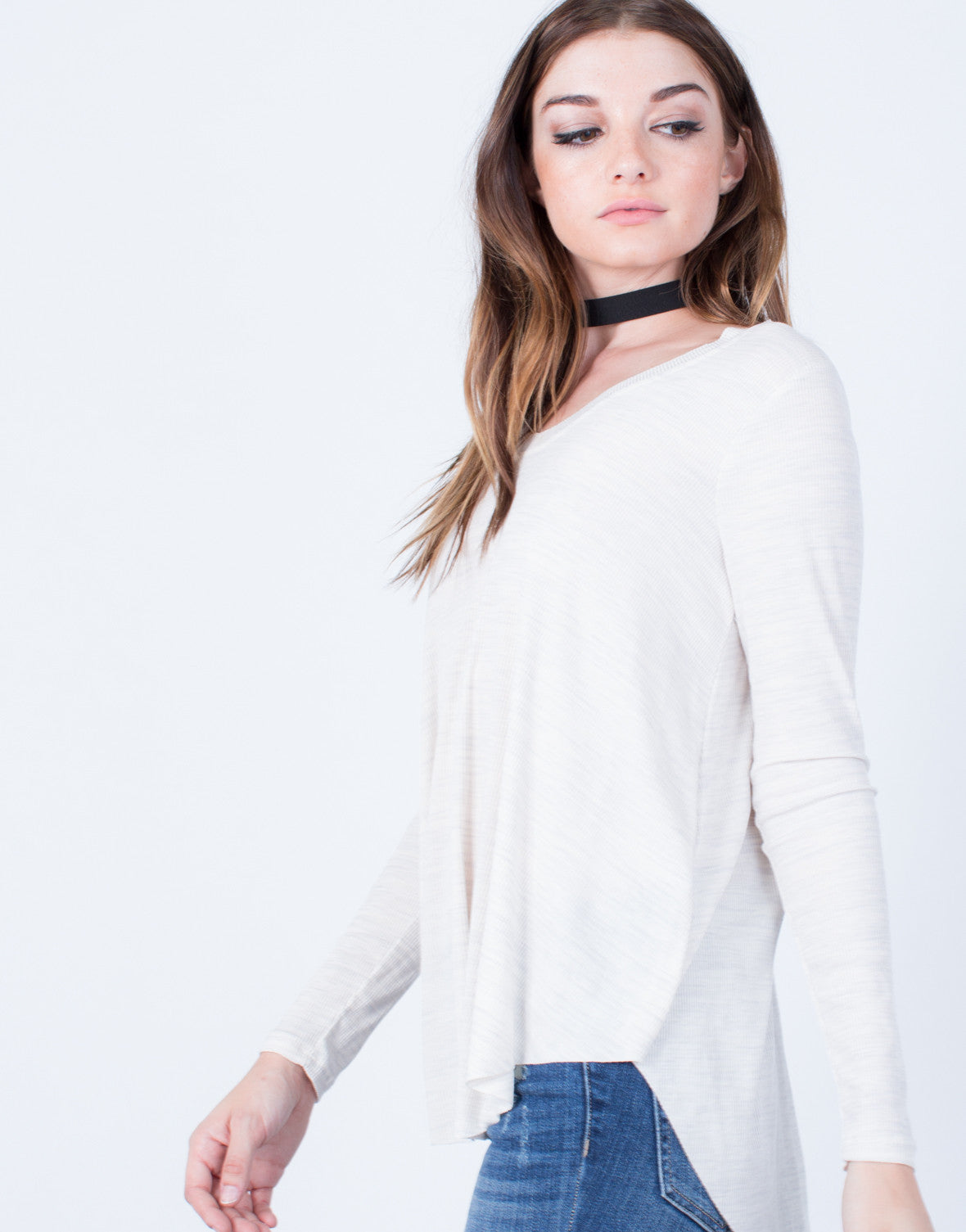 Detail of Curved Hem Knit Top