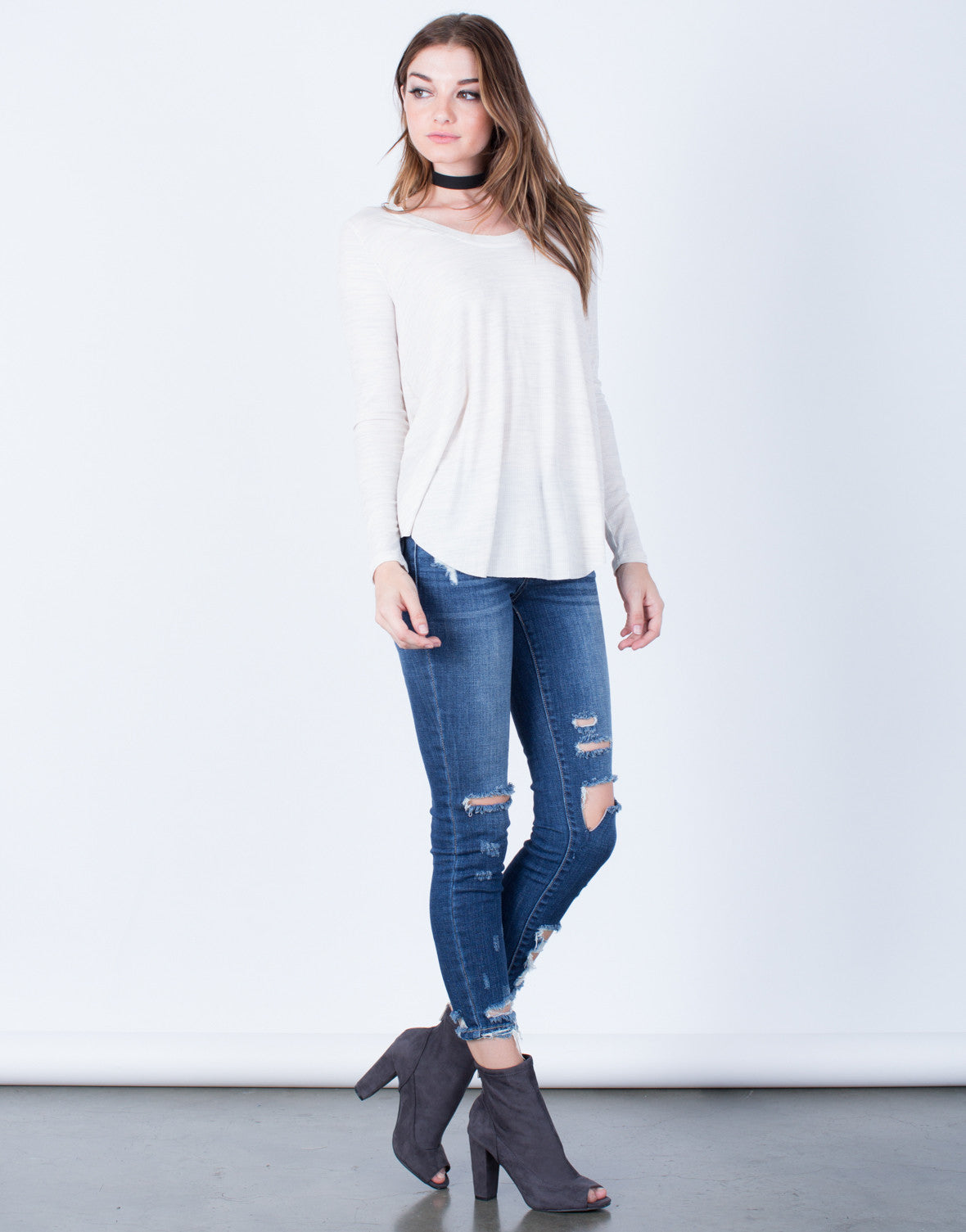 Side View of Curved Hem Knit Top